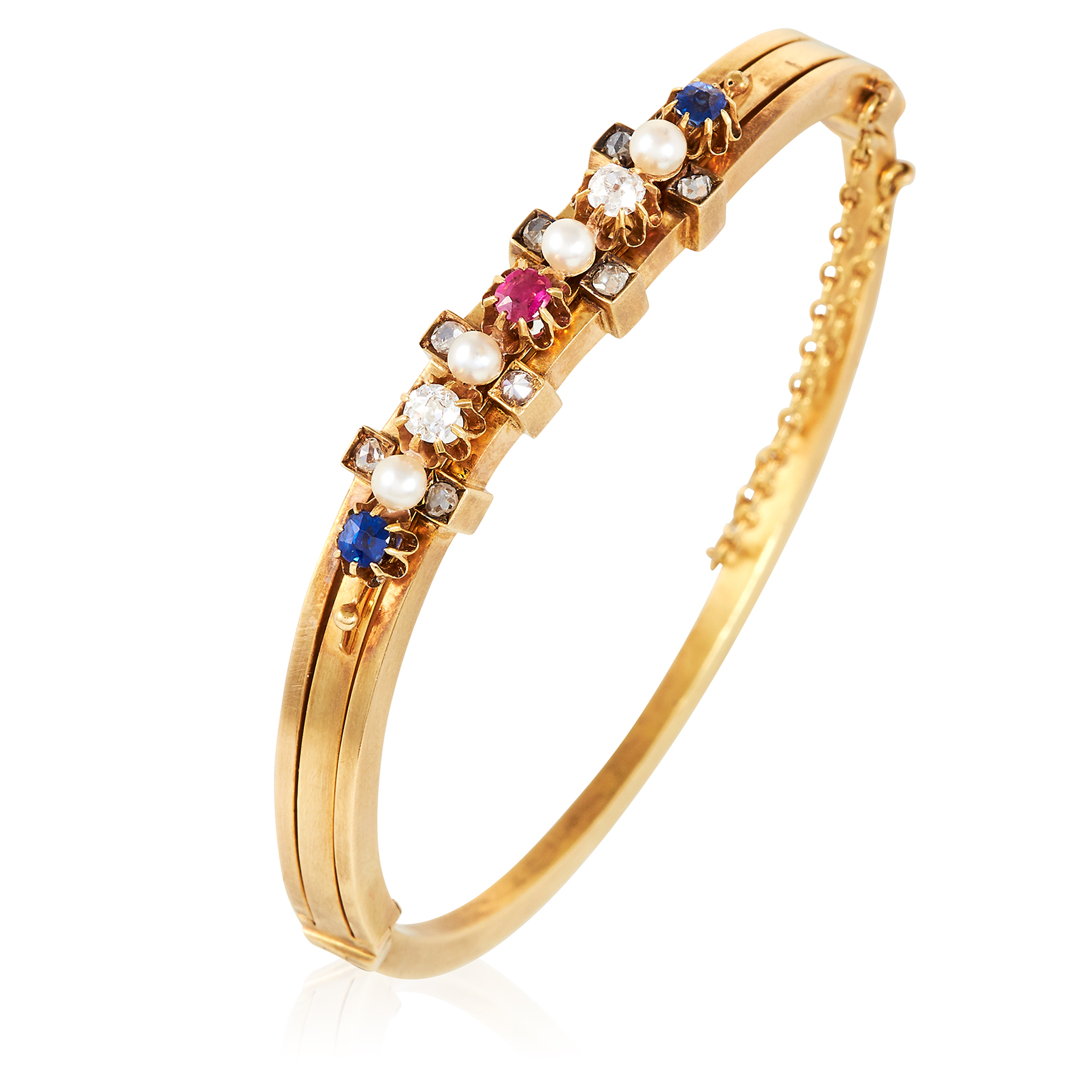 Los 2 - AN ANTIQUE RUBY, SAPPHIRE, PEARL AND DIAMOND BANGLE in high carat yellow gold, the undulating body