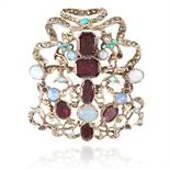 AN ANTIQUE GARNET, OPAL AND TURQUOISE BROOCH set with an array of gems, accented by marcasite,