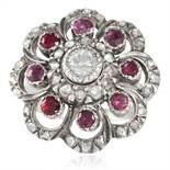 AN ANTIQUE DIAMOND AND RUBY RING, DUTCH 19TH CENTURY in yellow gold and silver, concentric rows of