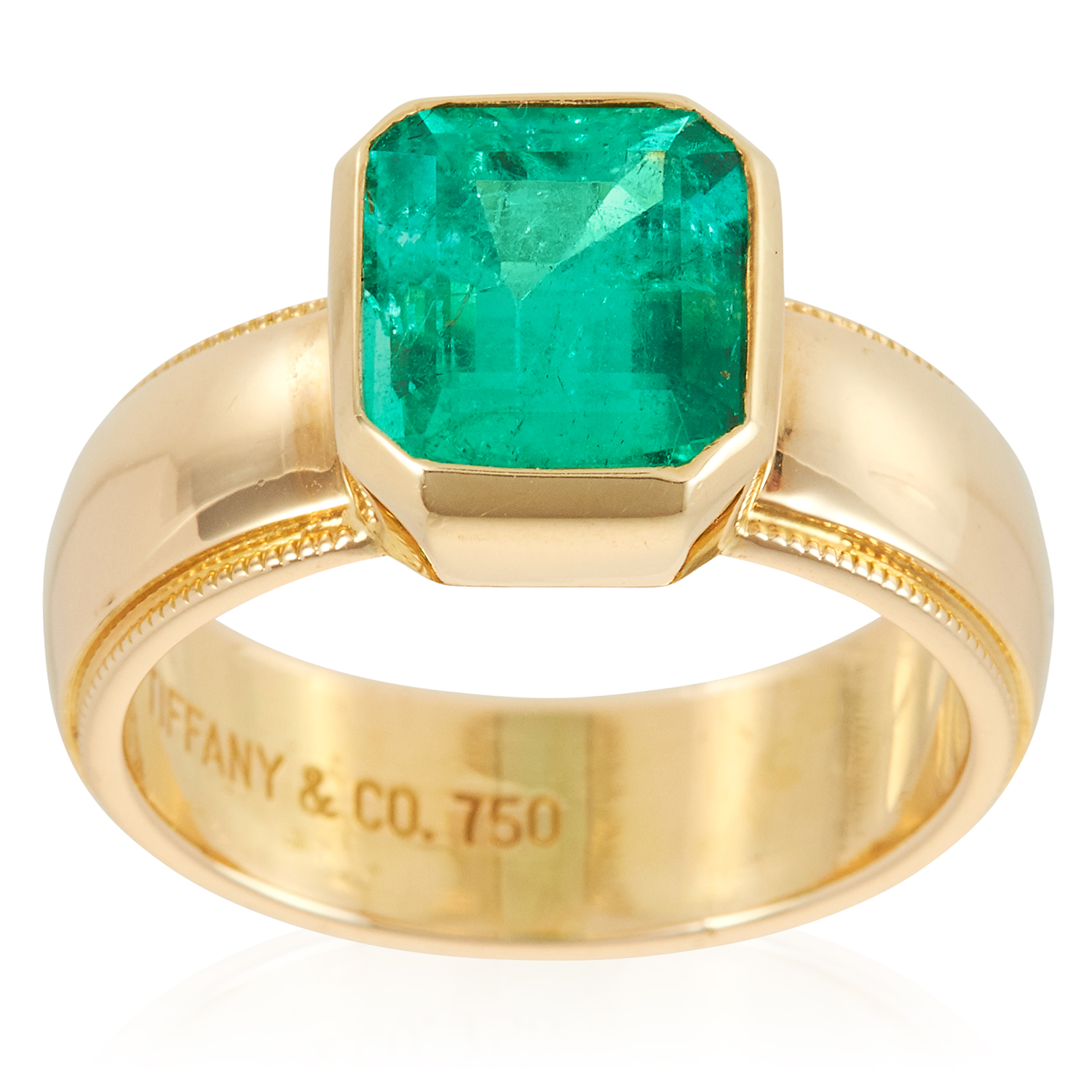 Los 14 - A 2.85 CARAT COLOMBIAN EMERALD RING, TIFFANY & CO in 18ct yellow gold, set with a step cut emerald