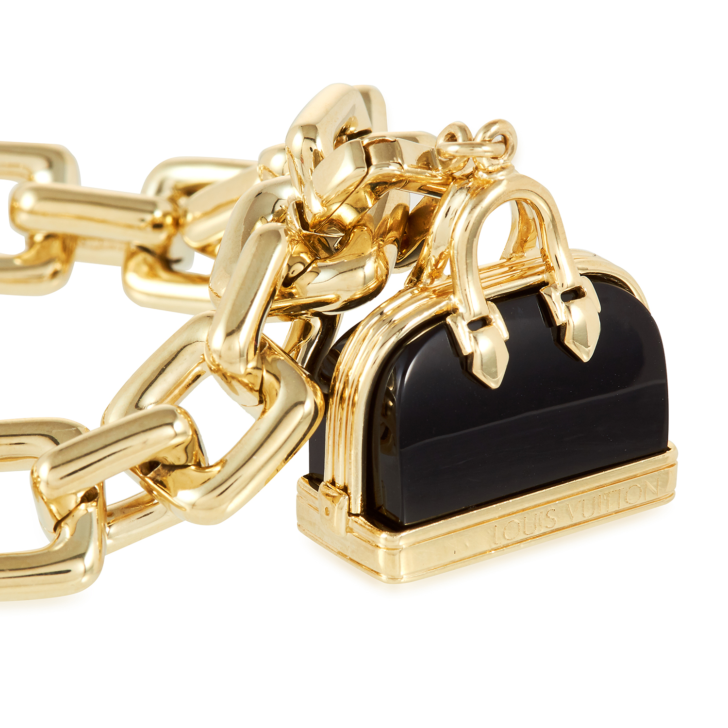 Los 19 - AN ONYX CHARM BRACELET, LOUIS VUITTON in 18ct yellow gold, set an with onyx handbag charm, a padlock