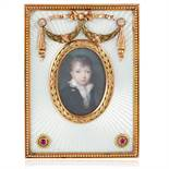 AN ANTIQUE RUBY, DIAMOND AND ENAMEL MINIATURE FRAME, HENRIK WIGSTROM FOR FABERGE, CIRCA 1905 in