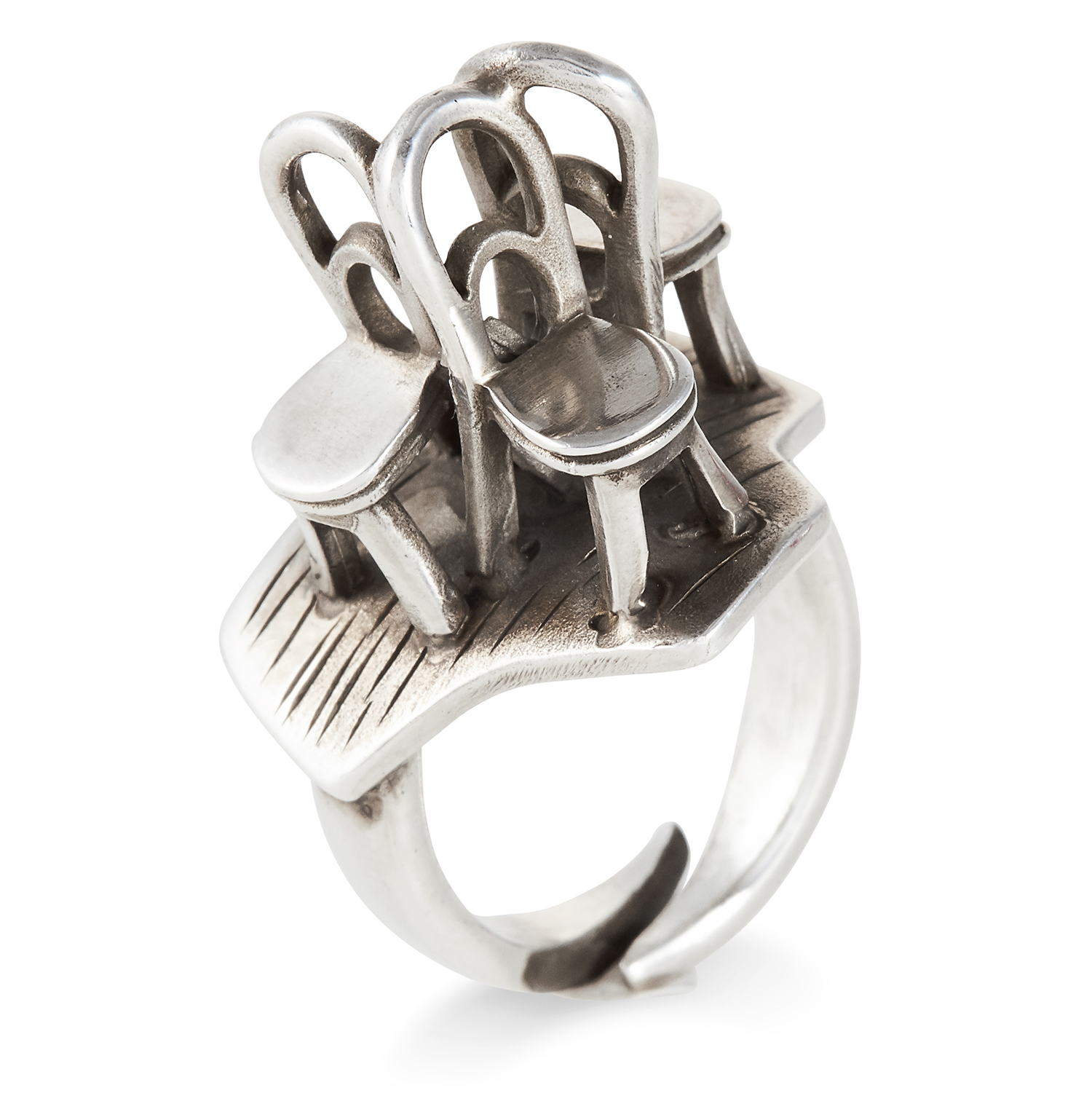 Los 77 - A SILVER RING, GEORG JENSEN in sterling silver, depicting three chairs, stamped 925, size M / 6,