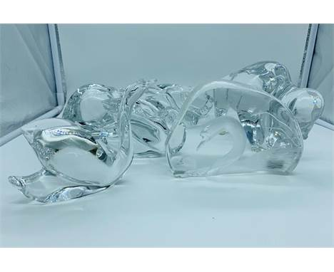 A collection of five Baccarat crystal animals to include a signed swan paperweight