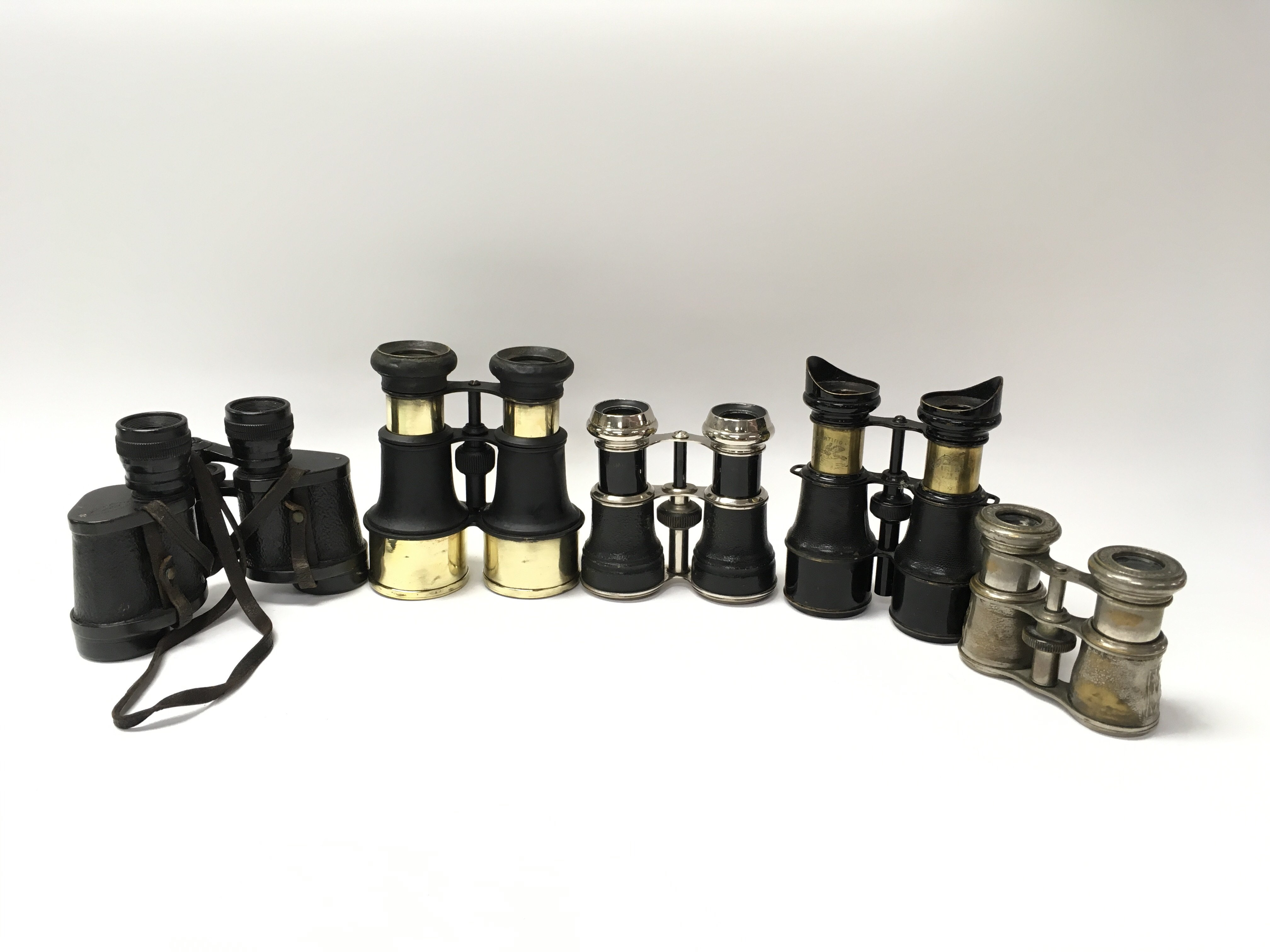 Lot 2268 - Five pairs of vintage binoculars to include Barr & Stroud.