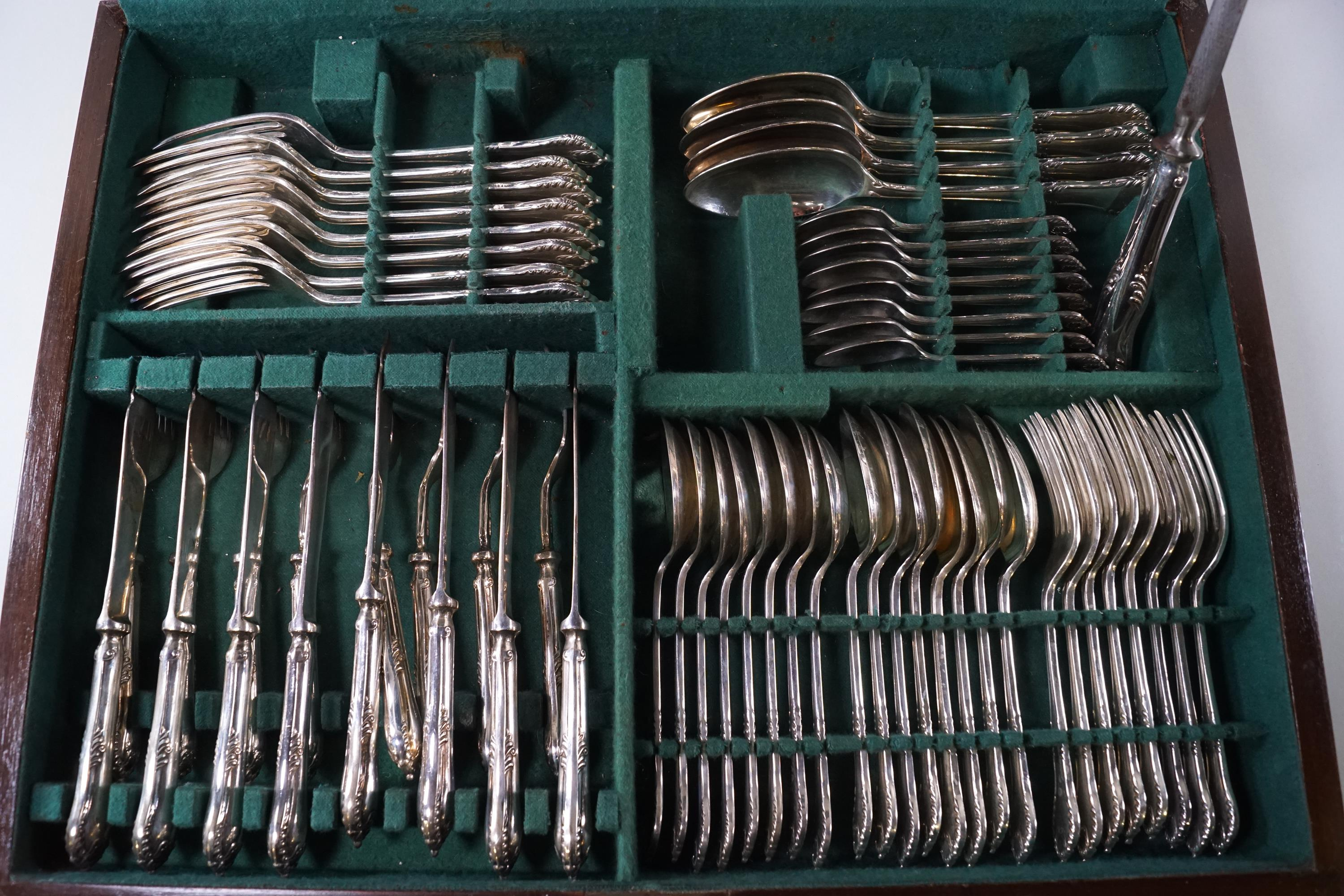 Lot 31 - A cased silver, double struck flatware and cutlery service.