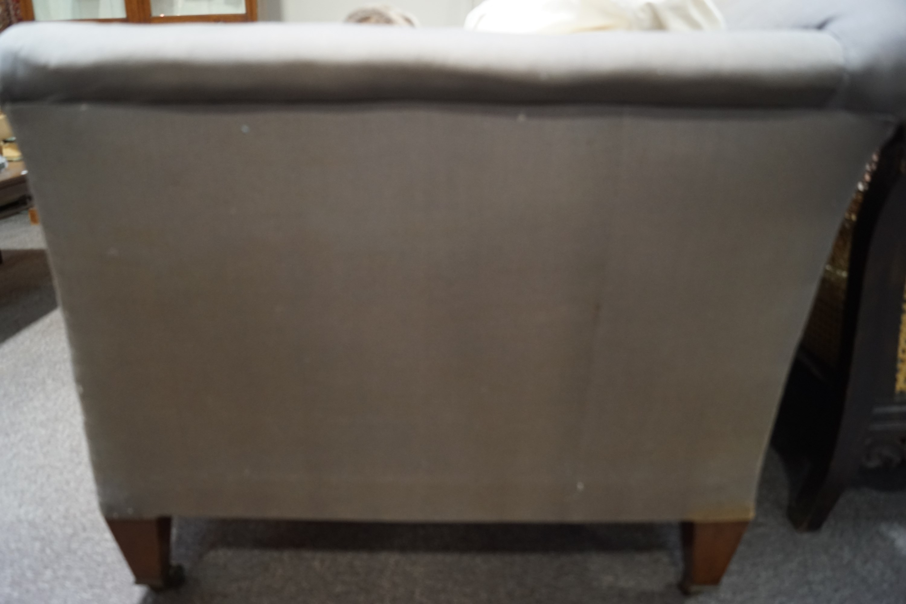 Lot 475 - A Howard & Sons sofa on square tapering legs,