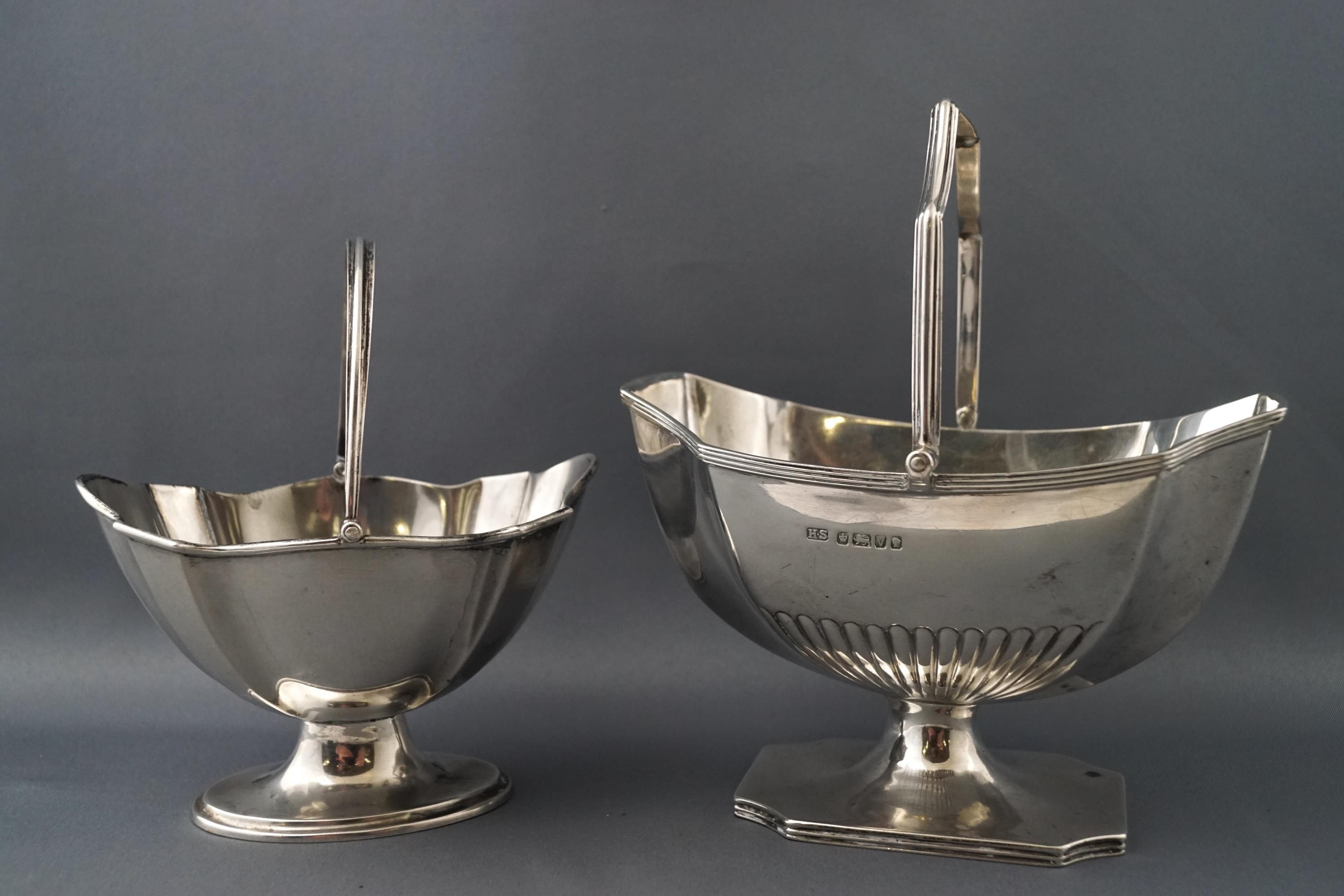 Lot 51 - A silver shaped octagonal swing handled sugar basket with semi fluted decoration,