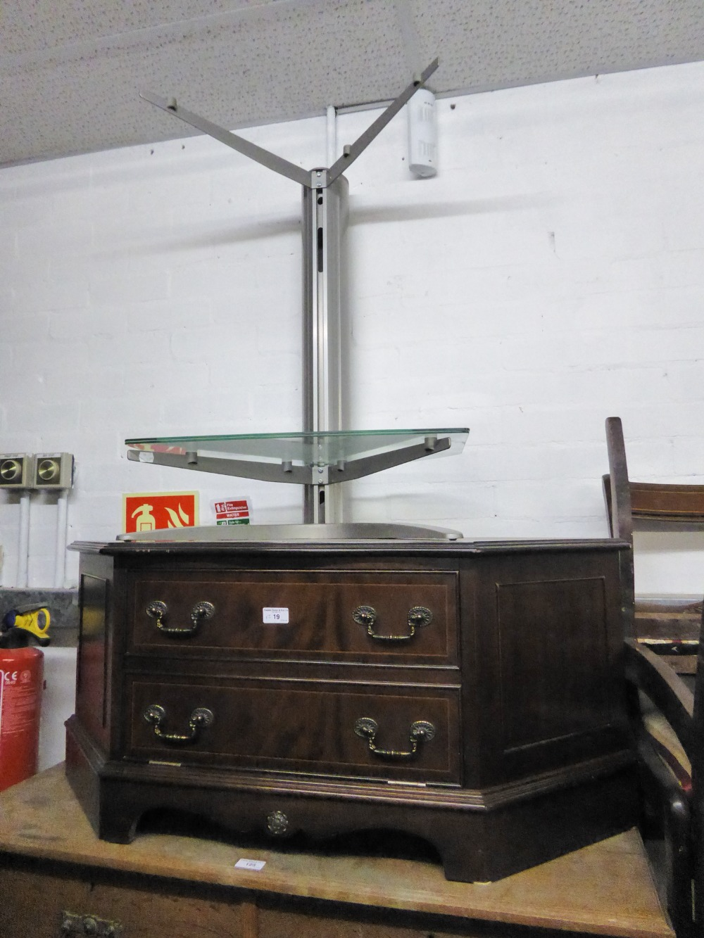 Lot 19 - A MAHOGANY CORNER TELEVISION STAND WITH FALL FRONT, AND A GREY CANTILEVER STAND WITH TWO PLATE GLASS