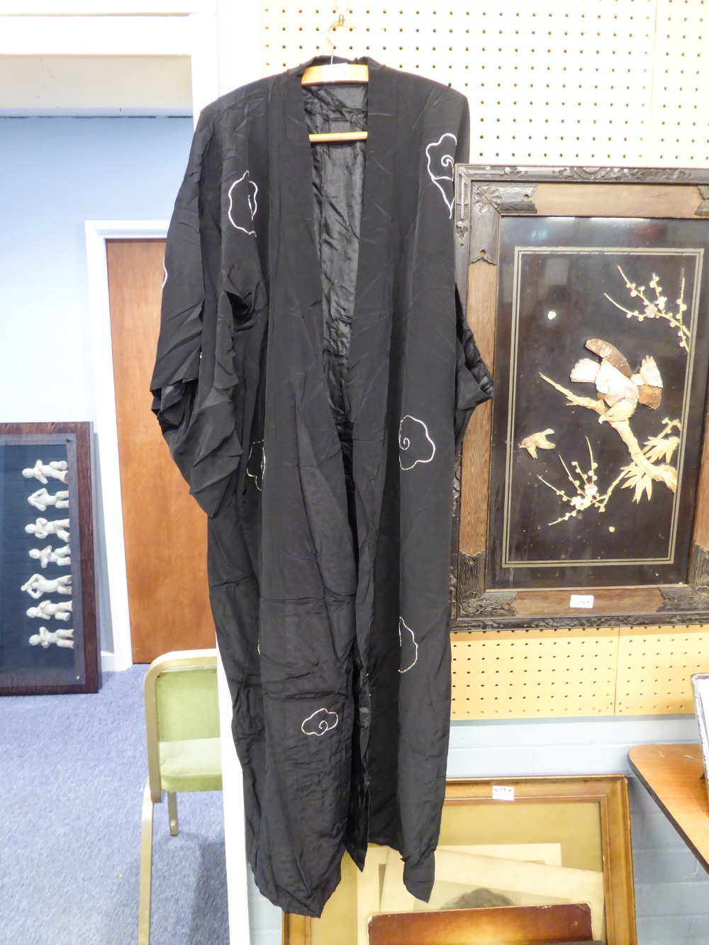 Lot 429 - CHINESE BLACK SILK FULL-LENGTH DRESSING GOWN, EMBROIDERED AND PADDED DECORATION IN COLOURED AND GOLD
