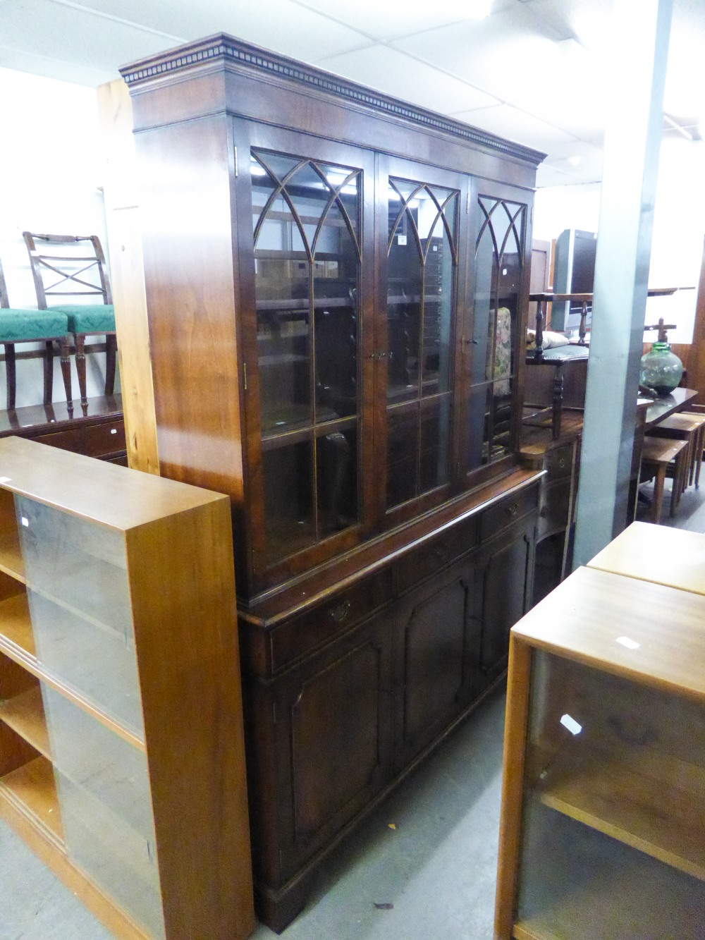 Lot 23 - A REPRODUCTION BOOKCASE, GLAZED UPPER PORTION WITH DRAWERS AND CUPBOARDS UNDER