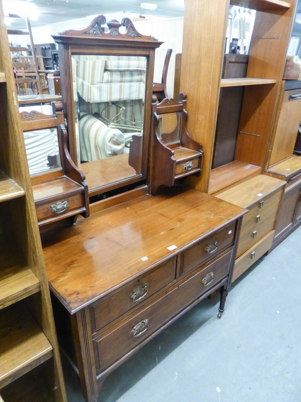 Lot 56 - AN EDWARDIAN WALNUTWOOD DRESSING CHEST WITH SWING MIRROR, TWO SHORT AND ONE LONG DRAWER