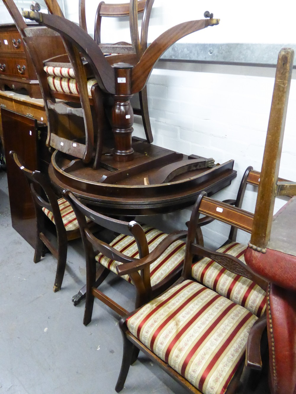 Lot 5 - A REPRODUCTION D- END DINING TABLE AND SIX CHAIRS (INCLUDING TWO CARVERS) HAVING STRIPED SILK PAD