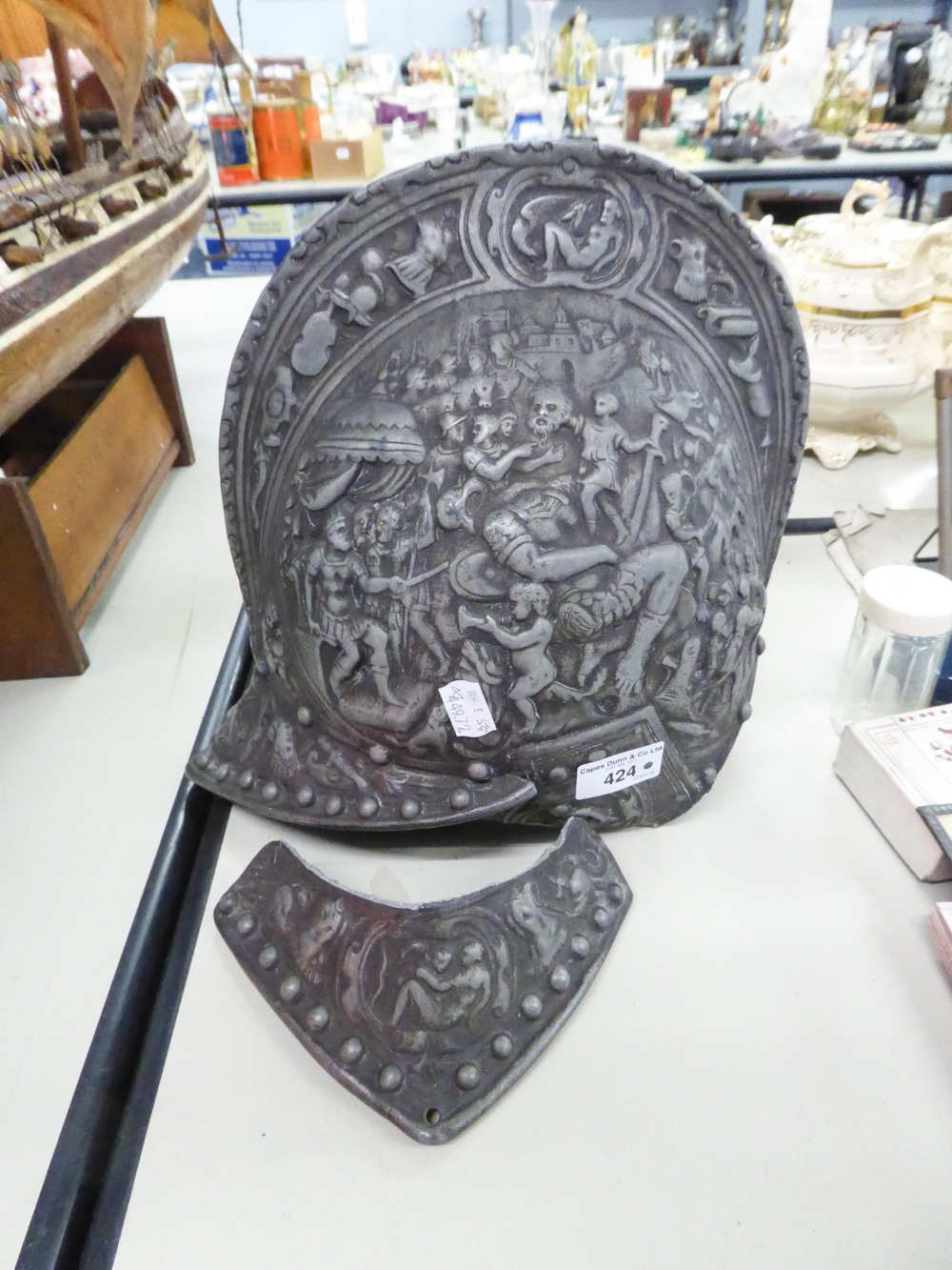 Lot 424 - OLD CAST METAL REPLICA OF AN ANCIENT WARRIOR'S HELMET, EMBOSSED WITH MANY FIGURES (AS FOUND)
