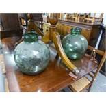 TWO GREEN GLASS DEMI-JOHNS (2)
