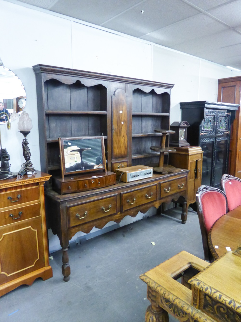 Lot 1 - A MID TWENTIETH CENTURY OAK DRESSER, THE RAISED BACK WITH THREE SHELVES EITHER SIDE OF A CUPBOARD