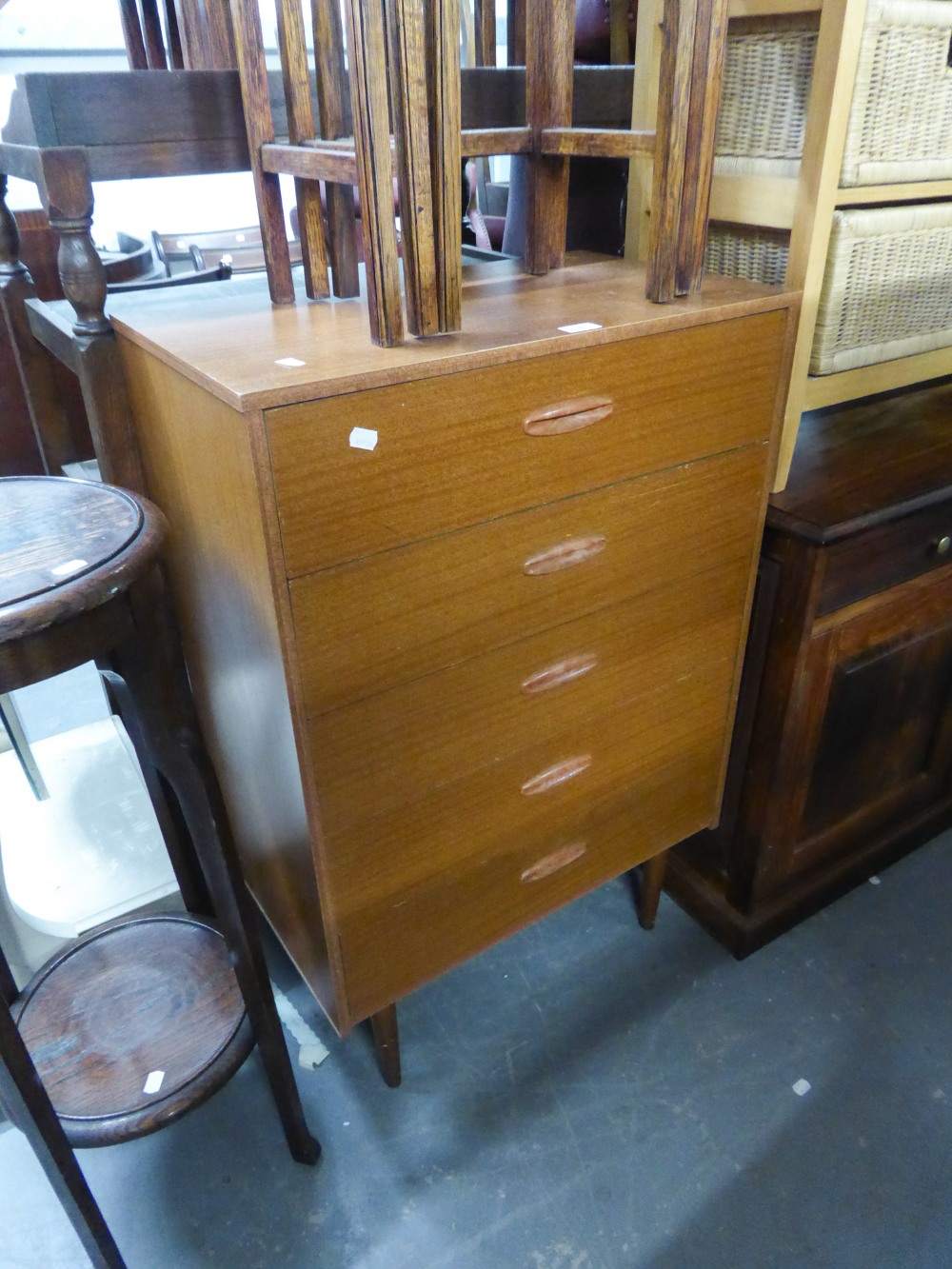 Lot 4 - G-PLAN TEAK CHEST OF DRAWERS, ON TURNED SUPPORTS