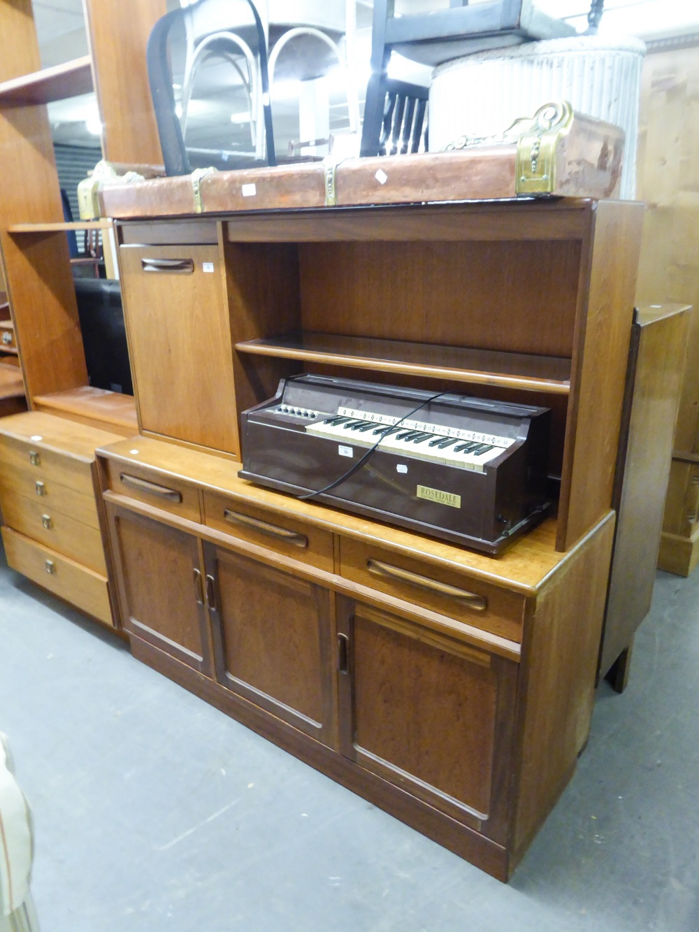 """Lot 46 - G-PLAN STYLE TEAK SIDEBOARD WITH RAISED BACK WITH SHELF AND FALL FRONT COCKTAIL SECTION, 4'7"""" WIDE"""