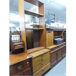 A MODERN TEAK CHEST OF FOUR LONG DRAWERS WITH TALL OPEN BOOKCASE SURMOUNTING
