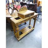 A 20TH CENTURY OAK HALL STAND WITH RAISED CENTRAL DRAWER HAVING LION HANDLE, UMBRELLA STANDS TO