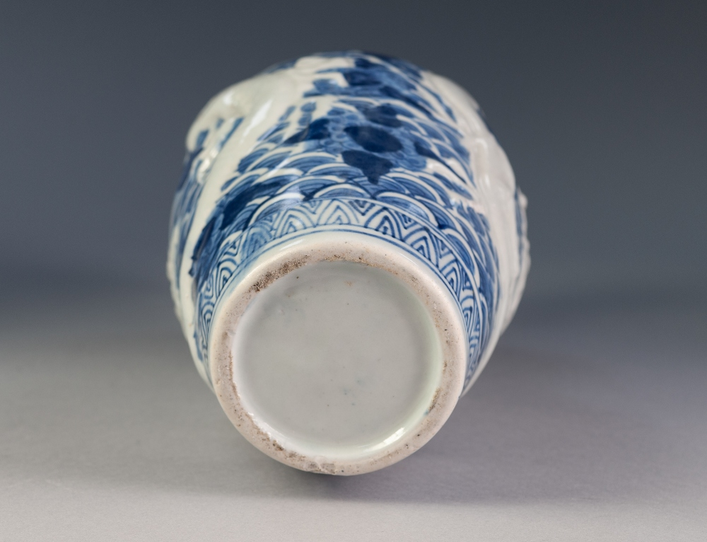 Lot 306 - CHINESE PORCELAIN BLUE AND WHITE OVULAR VASE, with waisted neck, embossed with white dragons on a