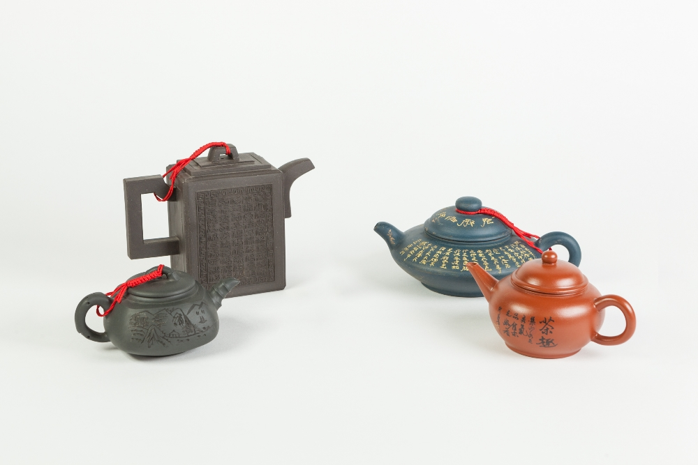 Lot 263 - FOUR CHINESE YIXING STONE CHINA TEAPOTS, in varying colour clays, also an INDIAN CARVED IVORY