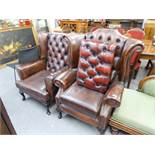 TWO OF BUTTON BACK FIRESIDE ARMCHAIRS, BROWN HIDE UPHOLSTERY WITH STUD DETAIL, RAISED ON CABRIOLE