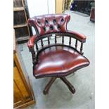 A REPRODUCTION CAPTAIN'S CHAIR, WITH RED HIDE UPHOLSTERY, ON OUTSWEPT SUPPORTS