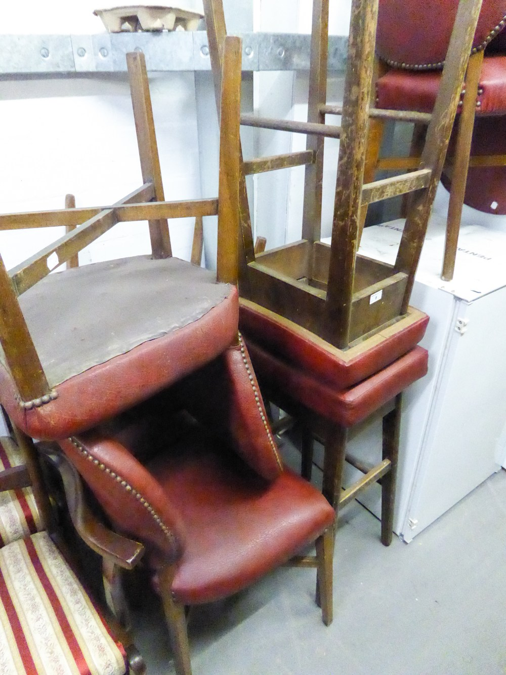 Lot 8 - EIGHT MODERN DINING CHAIRS HAVING RED HIDE PAD BACK AND SEAT, WITH STUD DETAIL AND TWO MATCHING