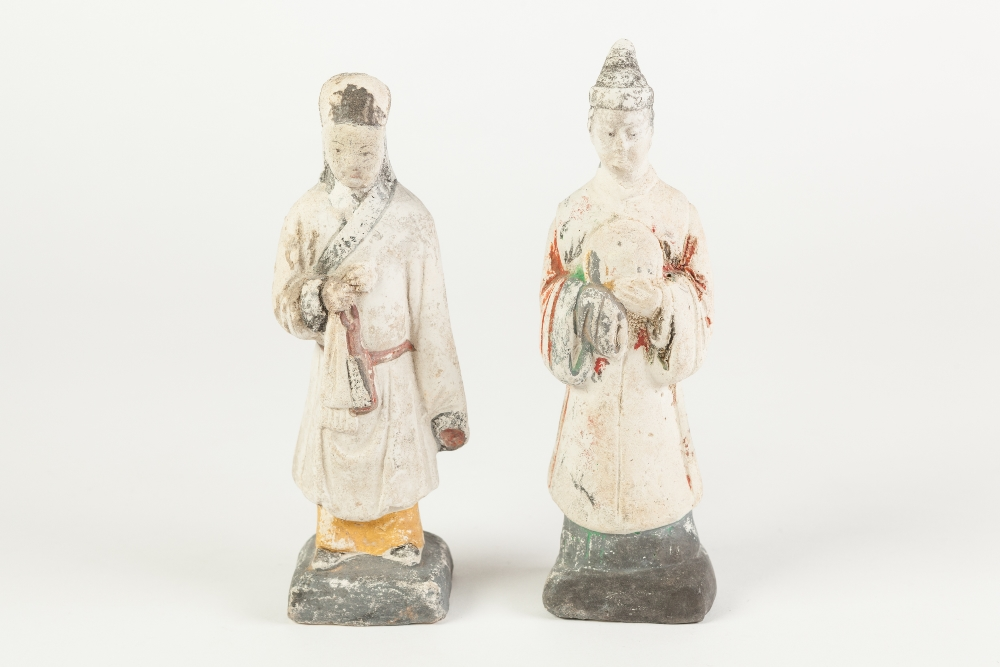 Lot 376 - A PAIR OF AGED CHINESE WHITE CHALK SURFACED TERRACOTTA BISCUIT ATTENDANT FIGURES with remnants of