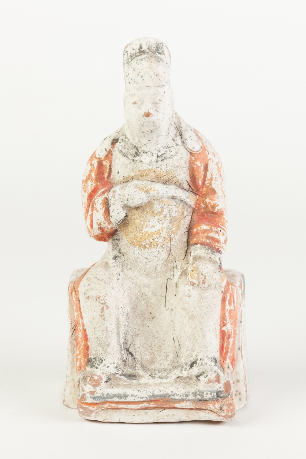 Lot 375 - AN AGED CHINESE WHITE CHALK SURFACED TERRACOTTA BISCUIT FIGURE of an enthroned dignitary with in