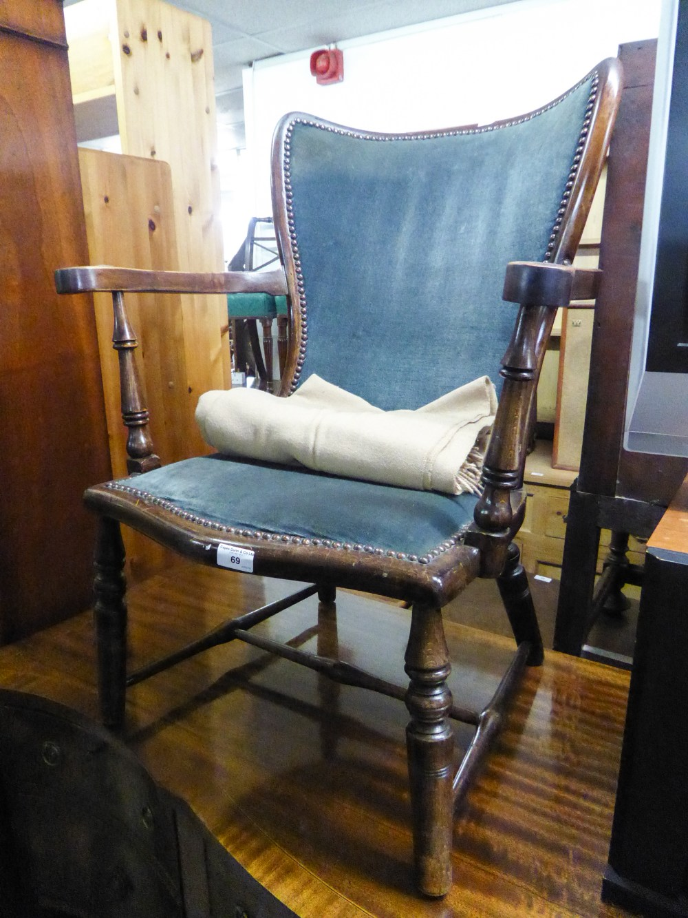 Lot 69 - A SMALL HARDWOOD, EARLY 20TH CENTURY NURSING ARMCHAIR WITH UPHOLSTERED BACK AND SEAT COVERED IN