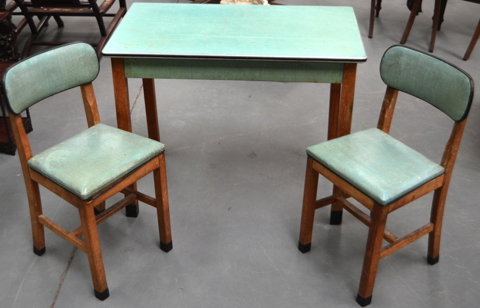 a retro 1940s/1950s kitchen table and two chairscantel, with