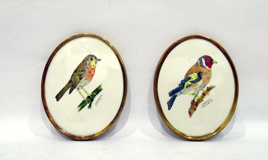 Lot 23 - Pair of Goebel wall plaques, one decorated with gold finch, the other with robin, both hand-