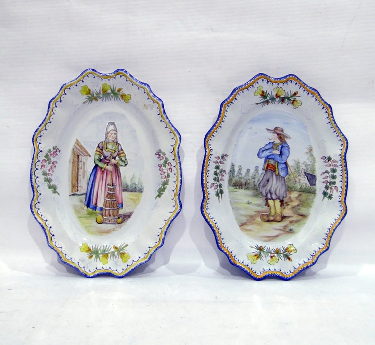 Lot 22 - Pair of Henriot Quimper wall plates, one decorated with Petit Breton pipe smoker, the other Petite