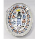 An early to mid 19th Century Quimper Breton decor platter measuring 34x25 cms,