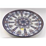 A large HB Quimper dished charger plate in Rouen decor marked P to base for M.