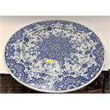 A large 19th Century blue and white Porquier beau charger, 67 cms diameter,