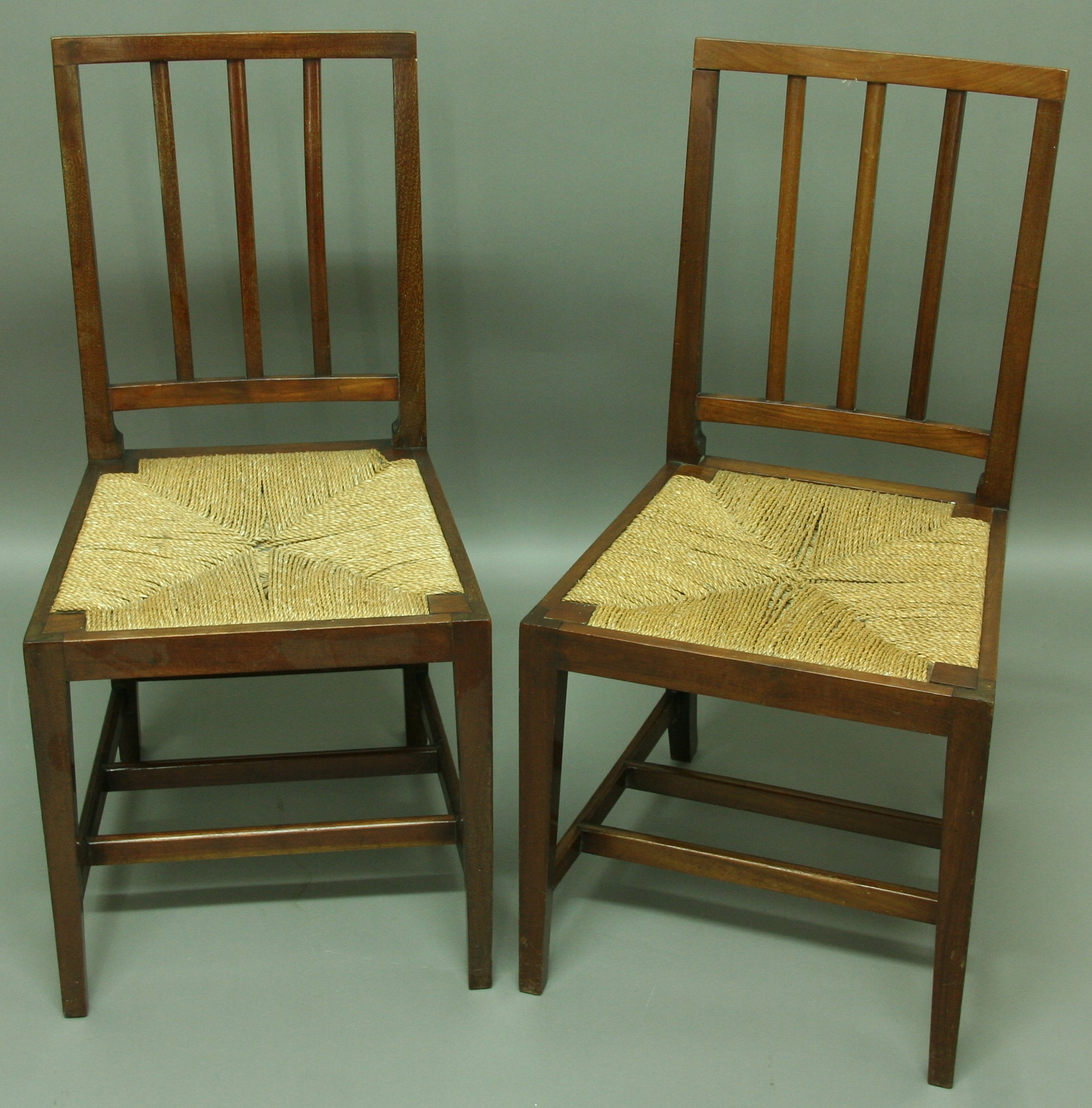 Lot 1912 - A PAIR OF MAHOGANY EDWARD VII CORONATION CHAIRS with rush seats st&ed & A PAIR OF MAHOGANY EDWARD VII CORONATION CHAIRS with rush seats ...