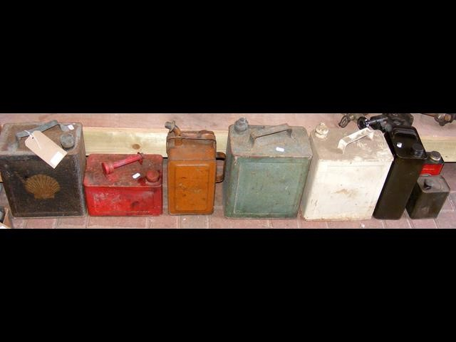 Lot 10 - An old Shell petrol can, together with others