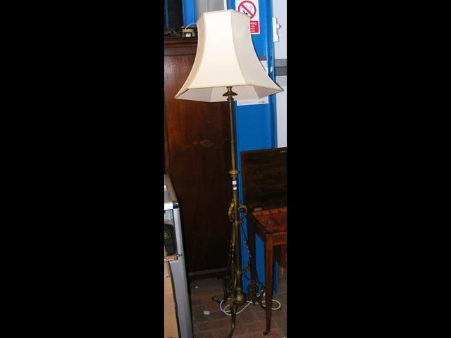Lot 32 - Adjustable brass standard lamp