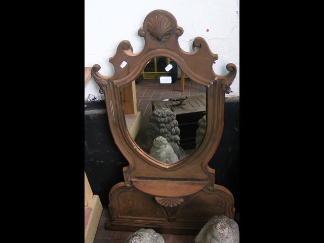 Lot 1 - A cast metal antique style wall mirror