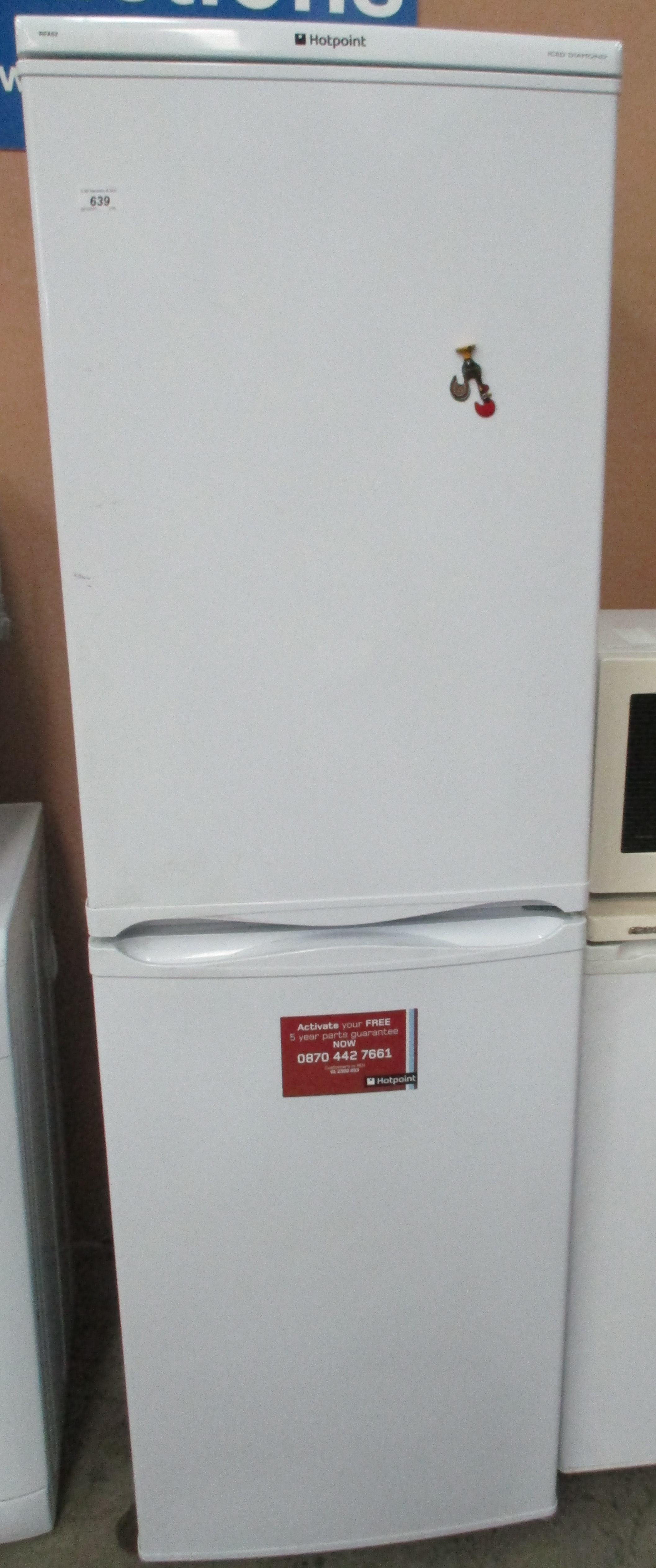 ... A Hotpoint Iced Diamond RFA52 upright fridge freezer
