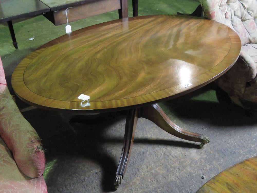 Lot 733 - A reproduction mahogany oval low centre