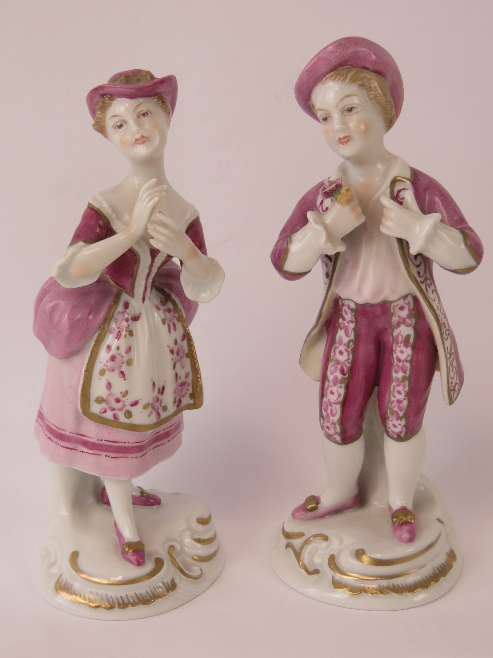 A pair of Continental porcelain figurine