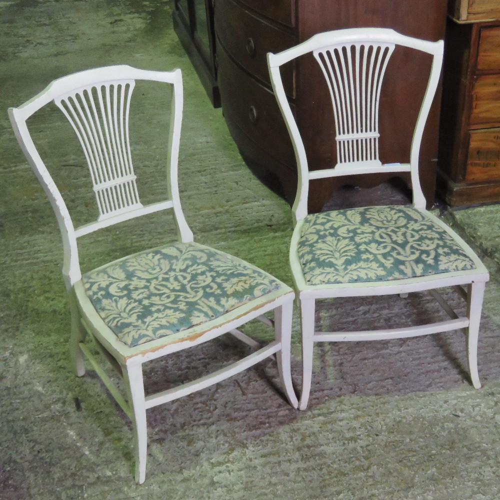 Lot 795 - A pair of low painted cream chairs of sm