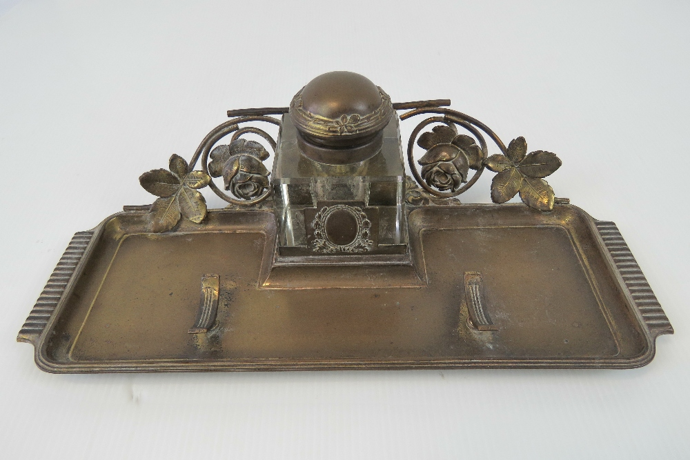 A brass standish having floral decoratio