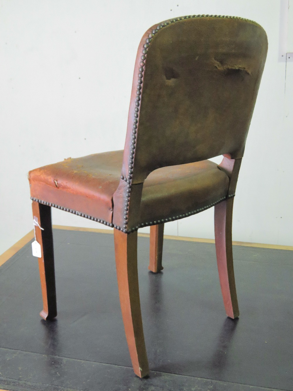 Lot 778 - A c1930s leather and studded mahogany bo