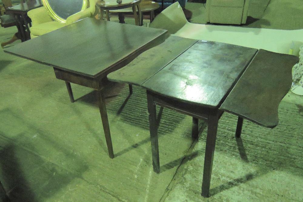 Lot 742 - A 19th century mahogany fold over tea ta