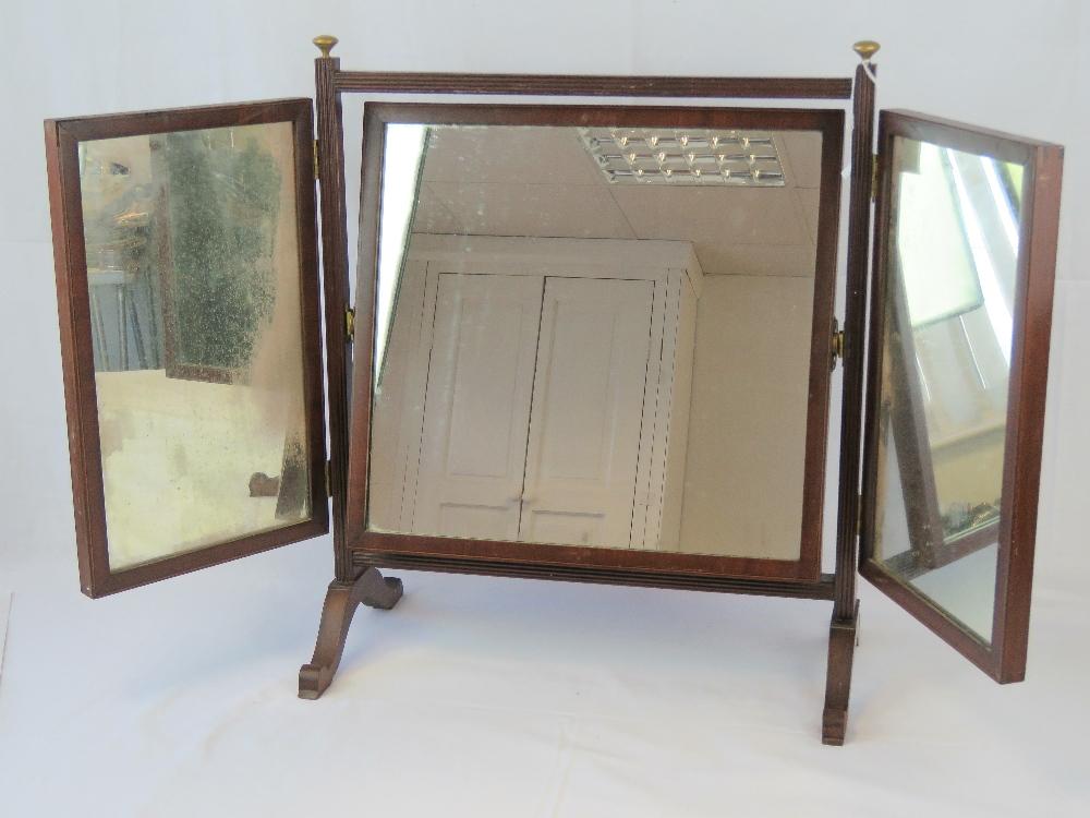 Lot 811 - A mahogany triptych dressing toilet mirr